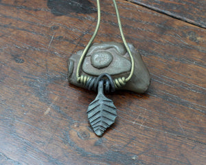 Medium forged iron leaf pendant on a green leather cord