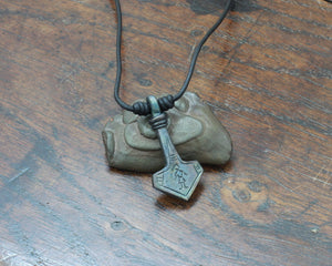 Thor's hammer pendant engraved with a image based on a iron age burial in Suotniemi, Finland