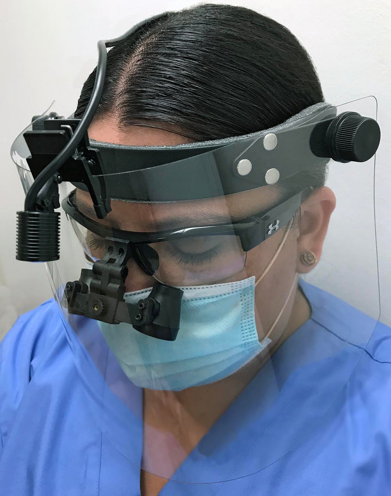 Front of SV Face Shield Loupe-Friendly System being used with flip-up loupes and ultra-mini LED headlight with Multi-Mini mounting clip