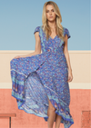 Rayon hi/lo blue/floral border print maxi with v neck, button front, ruffle short sleeves, shirred waist, and open back with 2 tie straps
