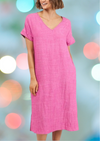 "Pink V neck cotton/linen blend knee length dress with cap sleeves, 2 side pockets and side splits.  Fabric:  Cotton / linen  Manny's measurements: Bust:  95cm (37.4"")  Waist: 75cm (29.5"")  Hips: 100cm (39.37"") She wears size Medium"