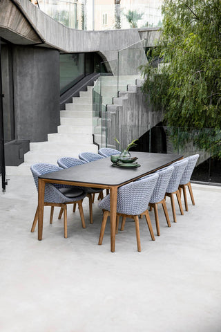 Modern dining set with teak details