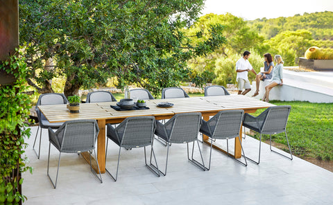 Beautiful dining table with modern grey chairs outdoor