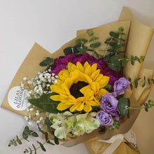 Load image into Gallery viewer, Sunflower and assortment of flowers from Lilasblooms for graduation includes carnations for graduating students in local universities in Singapore. Celebrate your friends proudest moment by gifting them a bouquet of flower.