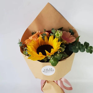 sunflowers, spray roses, and gerbera  which is perfect for gifing