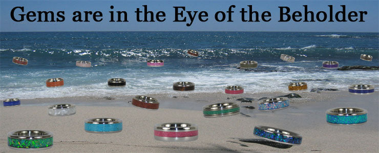 Gems are in the eye of the beholder - gemstone inlay titanium rings sitting on the beach in Hawaii