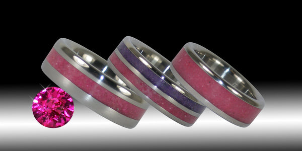Ruby gemstone and 3 of our Hawaii Titanium Rings inlaid with ruby