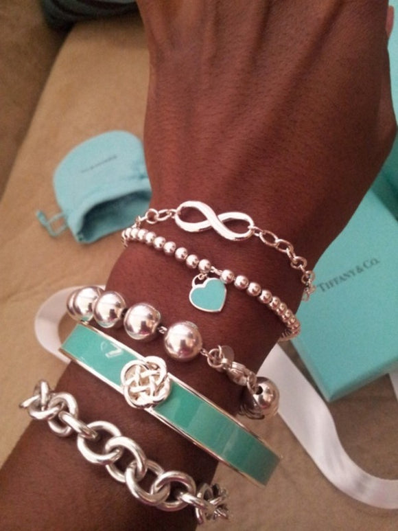 Stacking silver Tiffany bracelets stack