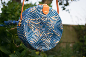 blue star design on round woven rattan bohemian bag
