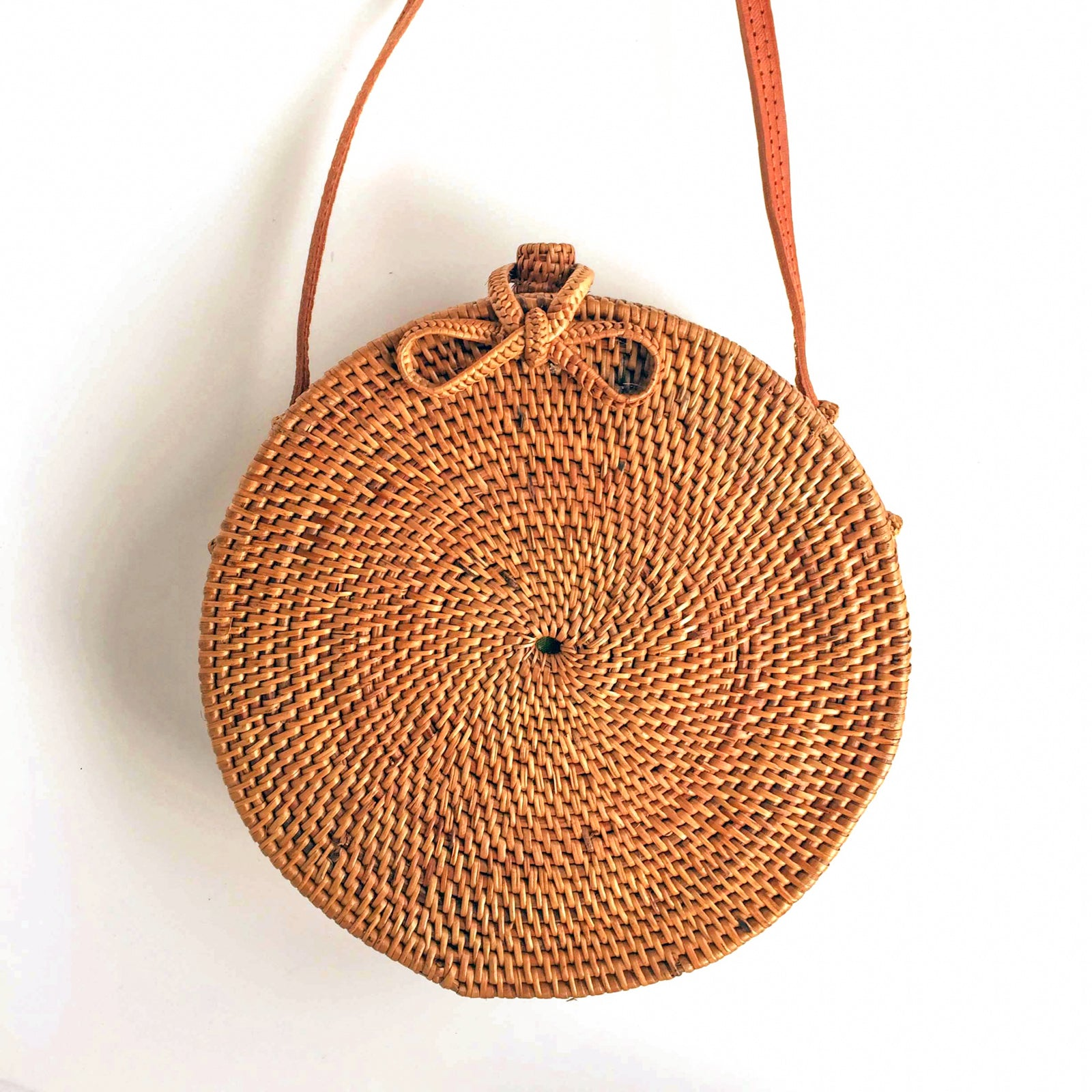 natural bow fastener design on round woven rattan bohemian bag