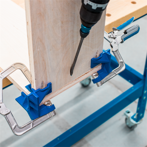 Clamp for holding boxes assemblies cases