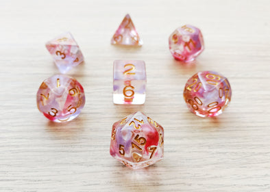 Clematis Edda Polyhedral Dice Set - Clear with Red and Lilac Swirls
