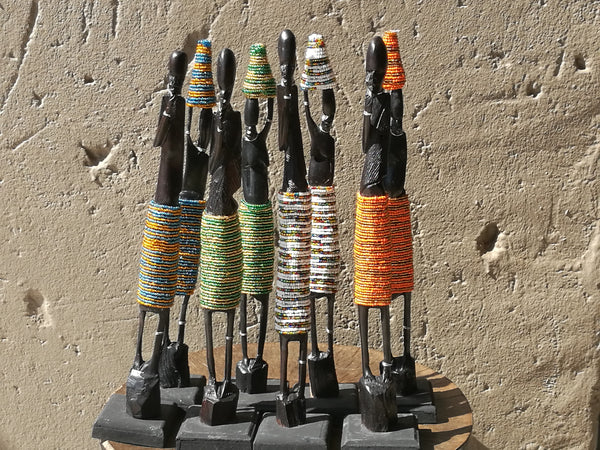 Ebony wood beaded figures.