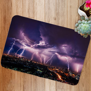 Lightning storm over city in purple light Bath Mat