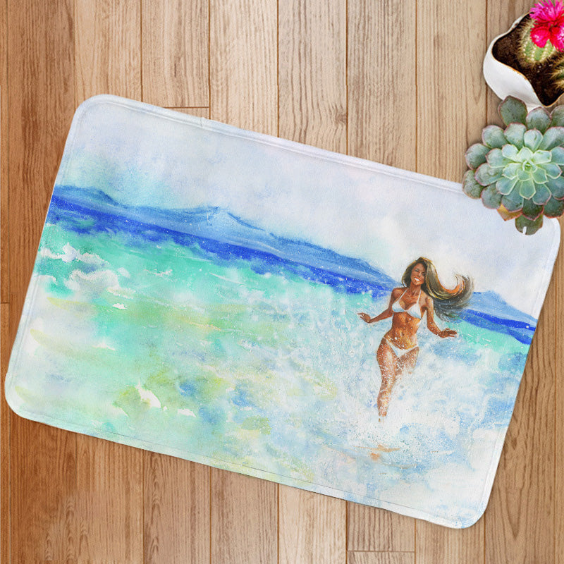 Woman on the beach Bath Mat