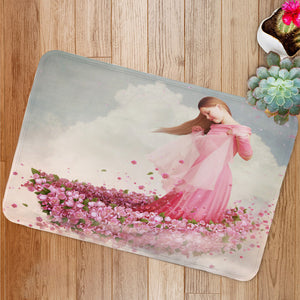 Girl in boat of flowers Bath Mat