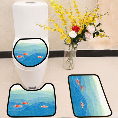 Three colorful fish swimming in a blue ocean 3 Piece Toilet Cover Set