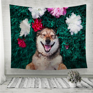 Smiling brown dog lies on a green meadow Wall Tapestry