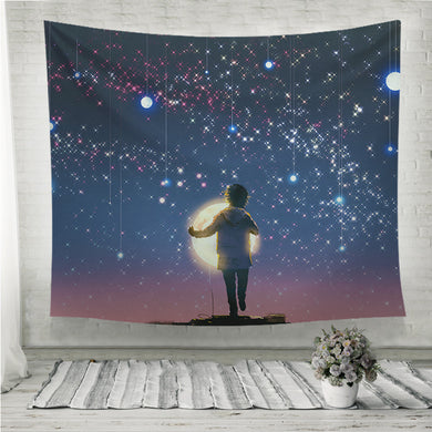 Boy holding glowing moon standing against hanging stars Wall Tapestry