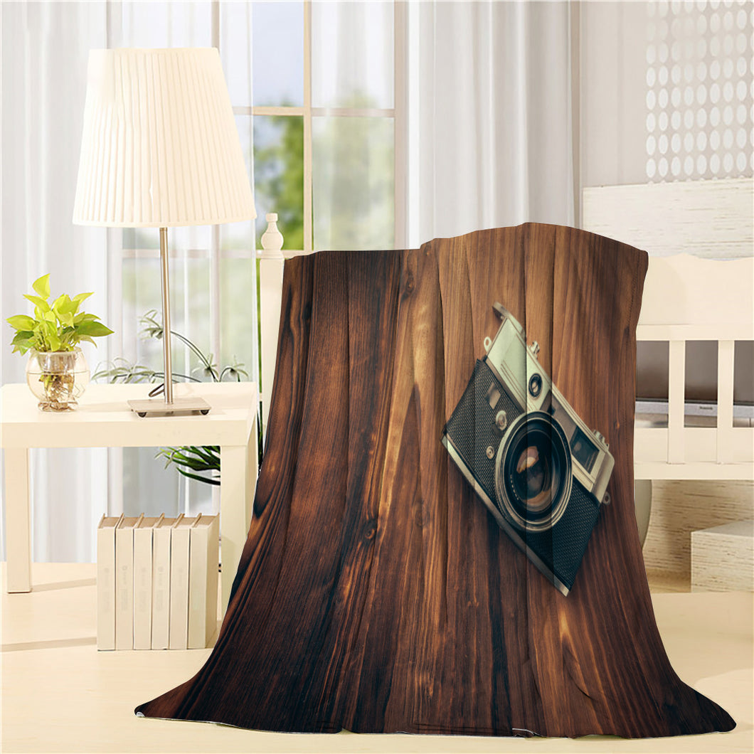 Vintage camera on wooden background Printed Throw Blanket