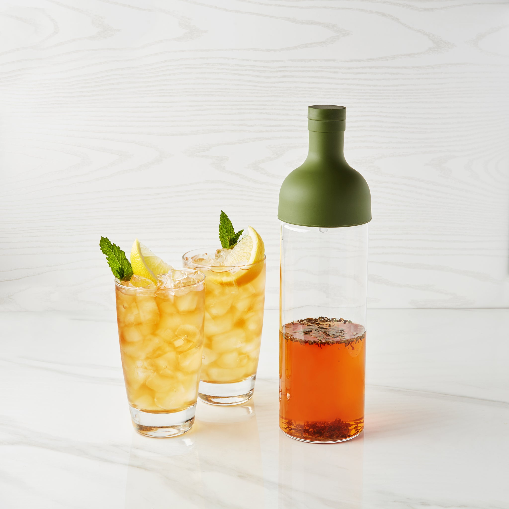 Hario filter-in cold brew bottle and glasses of cold brew tea