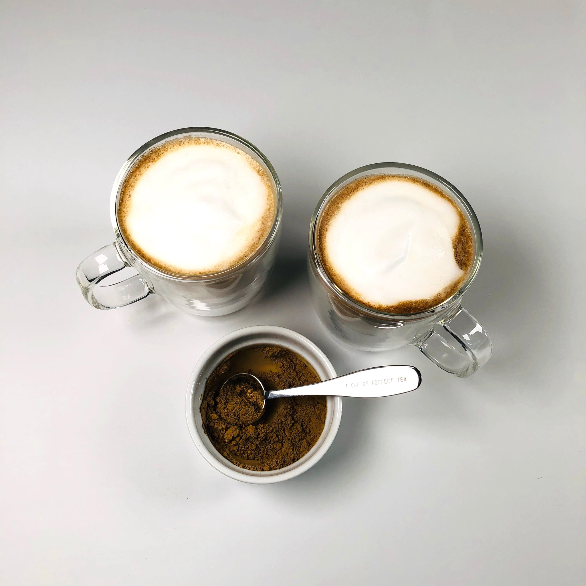 overhead shot of earl grey lattes and latte powder