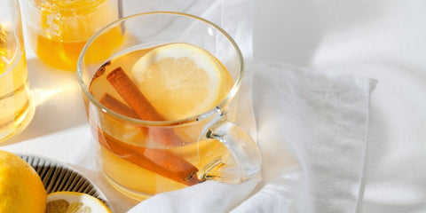 Hot Toddy with Lemon and a Cinnamon Stick
