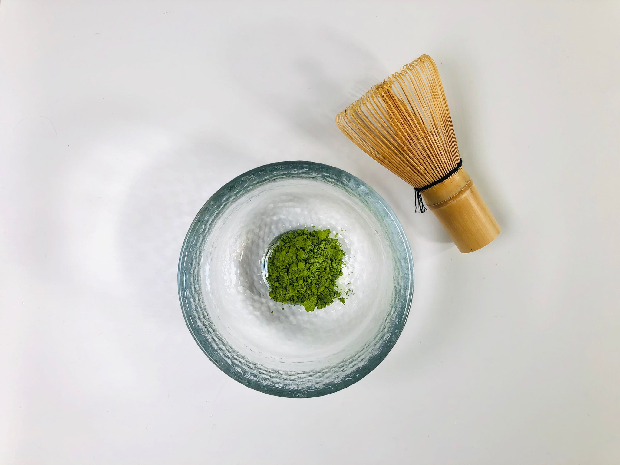 Matcha Powder in Bowl and Matcha Whisk