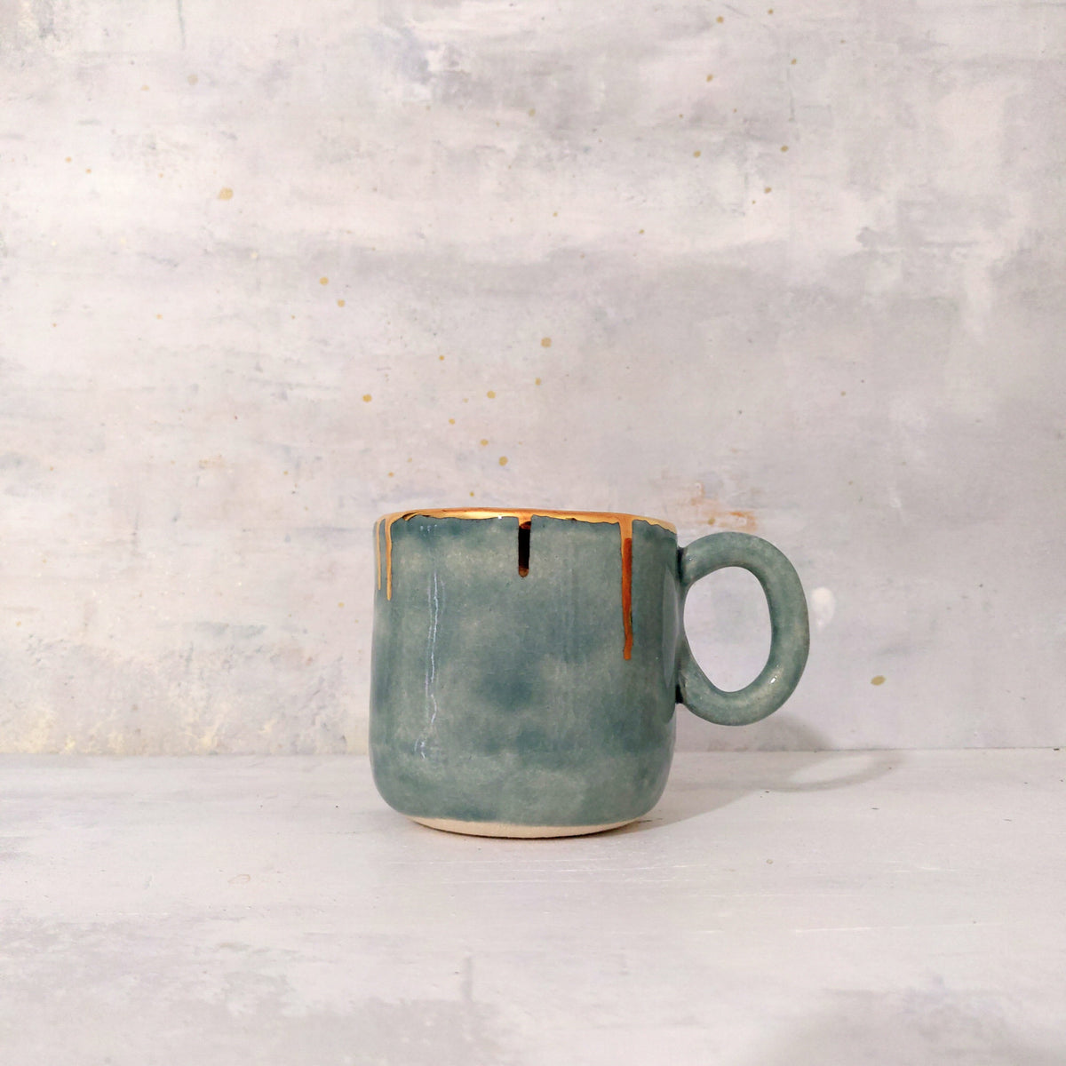 Mug in green fog and golden details