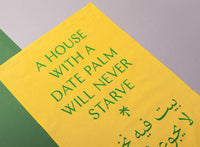 """A House With A Date Palm Will Never Starve"" Tea Towel x Michael Rakowitz"