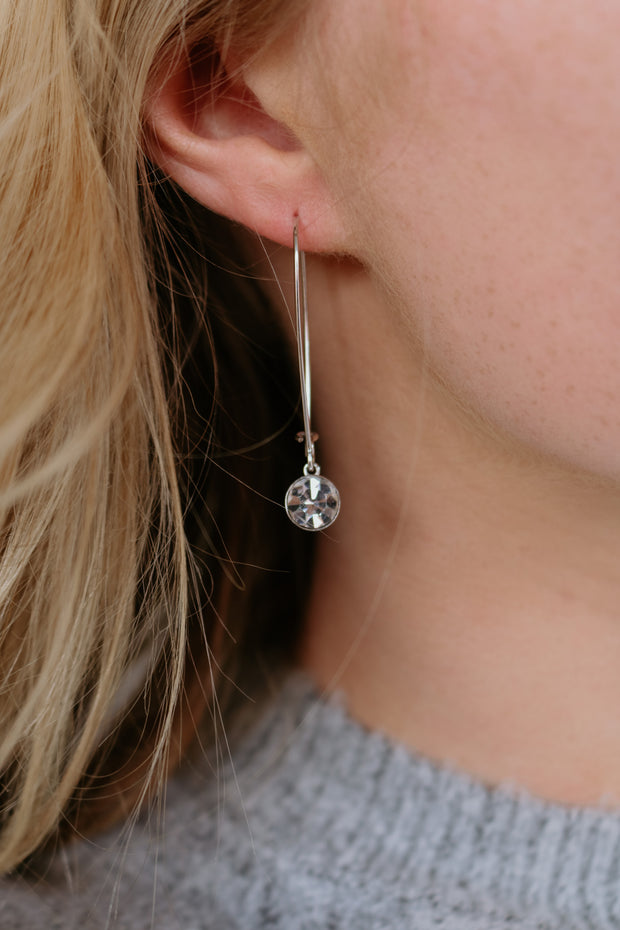 believe band: crystal drop earring with logo - crystal