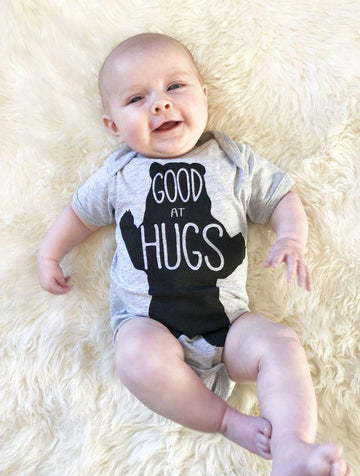 Good at Hugs Onesie - Baby Couture Co.