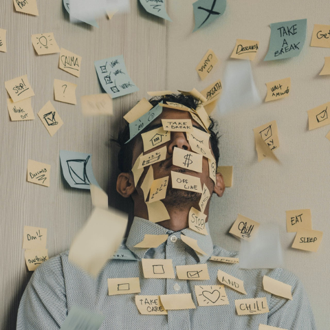 Man with sticky notes on face