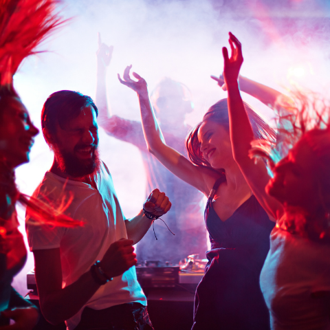 Friends dancing to music at a club