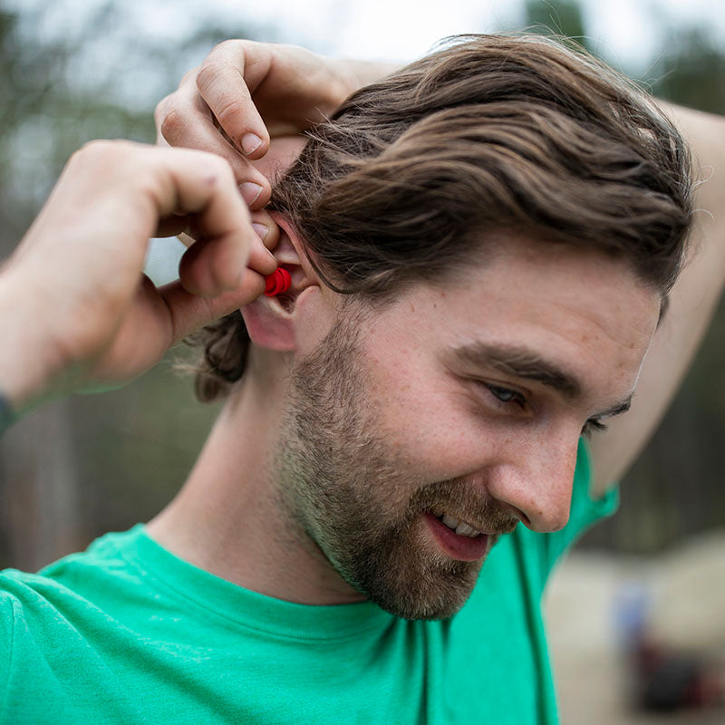 Guy putting in EarPeace safety ear plugs