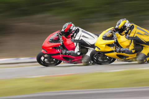 Motorcycle rallies and competitions have the energy of competition and education.
