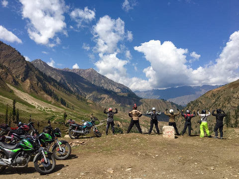Liza Miller and women's motorcycle riding group pose for strong image