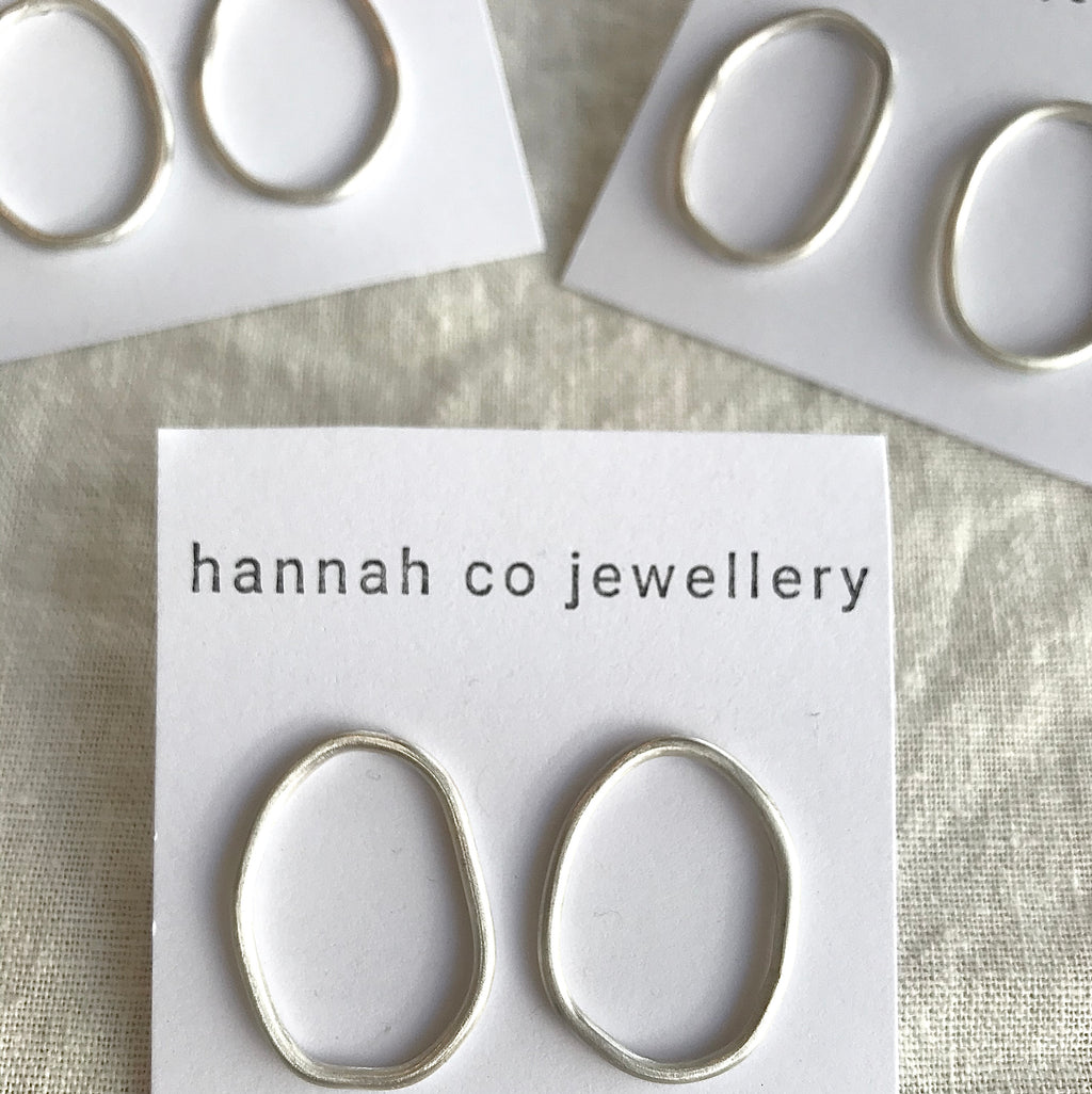 These beautiful organic shaped solid hoop studs are hand-made in Melbourne using 100% recycled sterling silver with a matte finish. Each piece is handcrafted and unique.