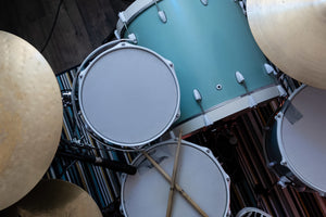 overhead picture of parts of a drum set including snare, tom, bass drum and cymbals