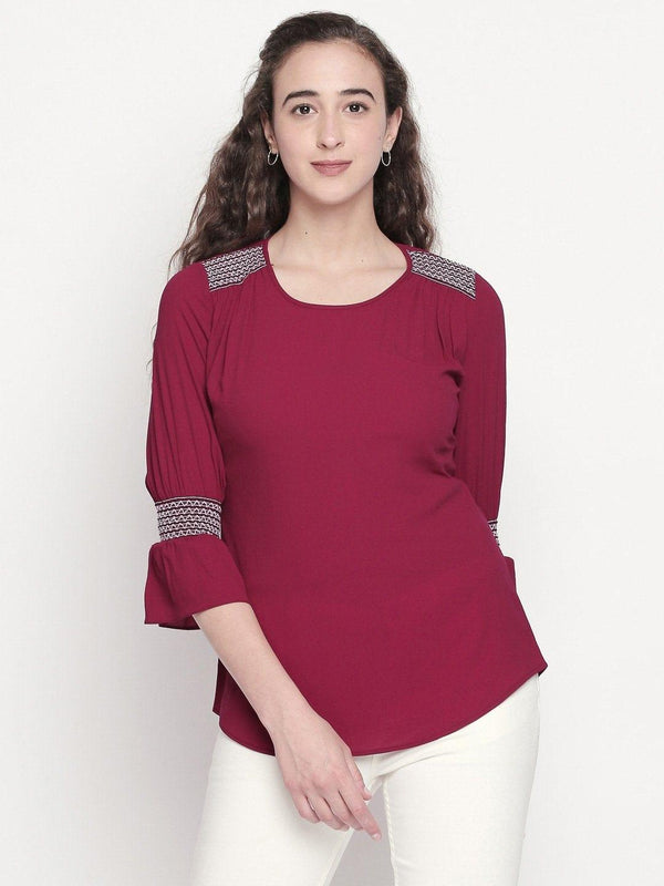 solid top with smocked sleeve