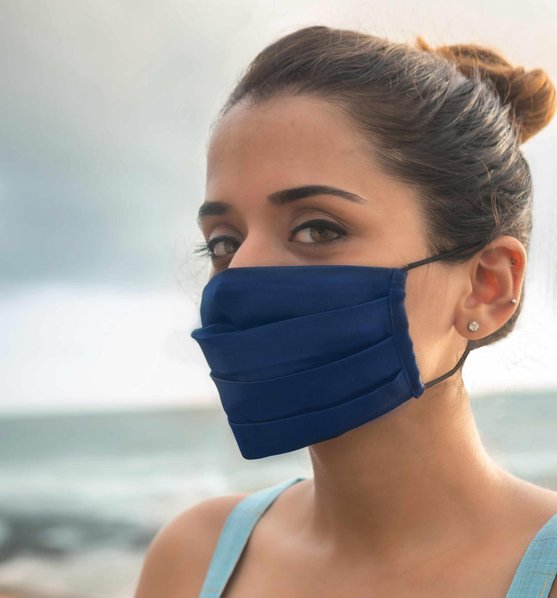Pretty girl wearing navy blue pleated mask available on mesmerize India. Made in India
