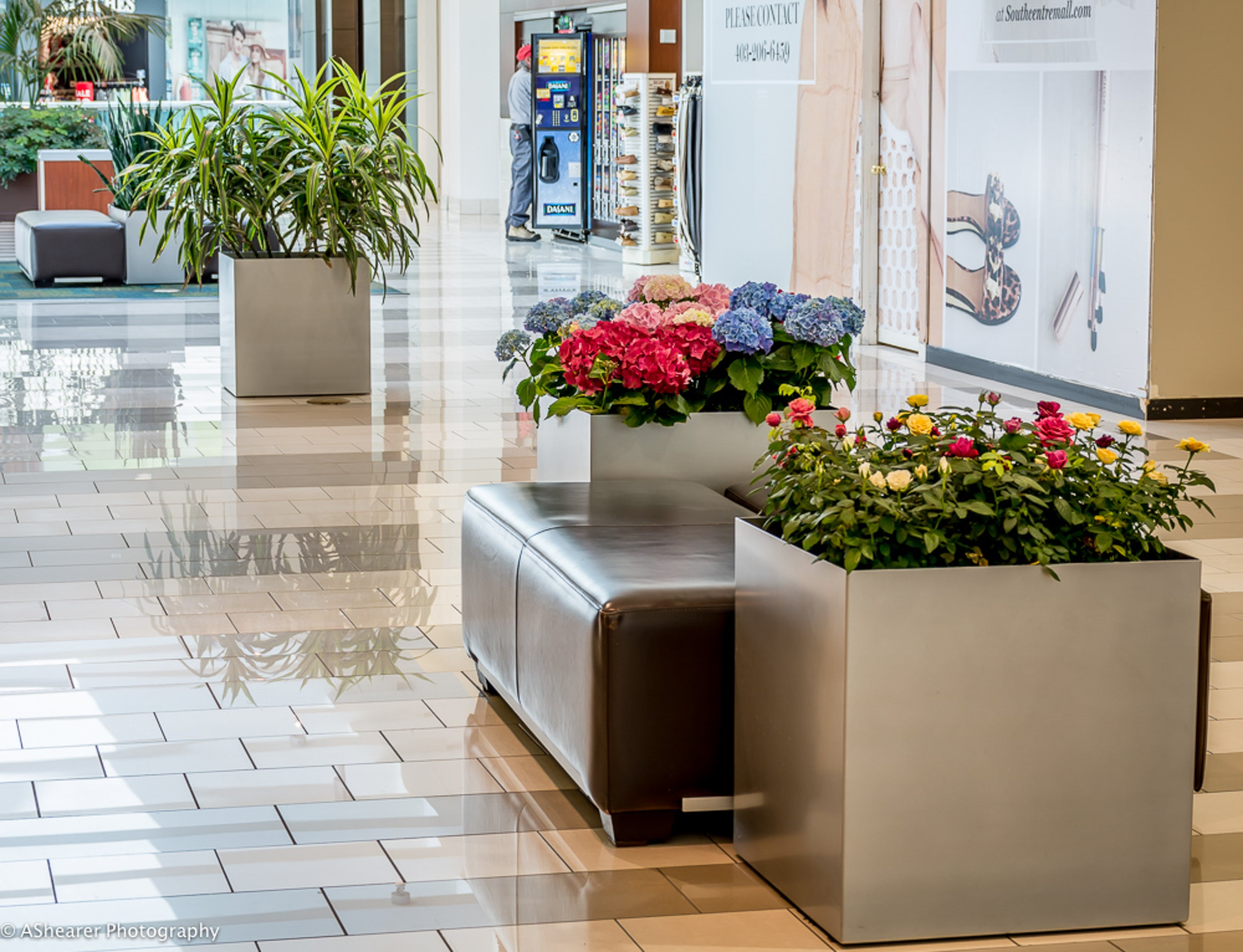 Leather bench between two Modern Elite Cube Planters in a mall