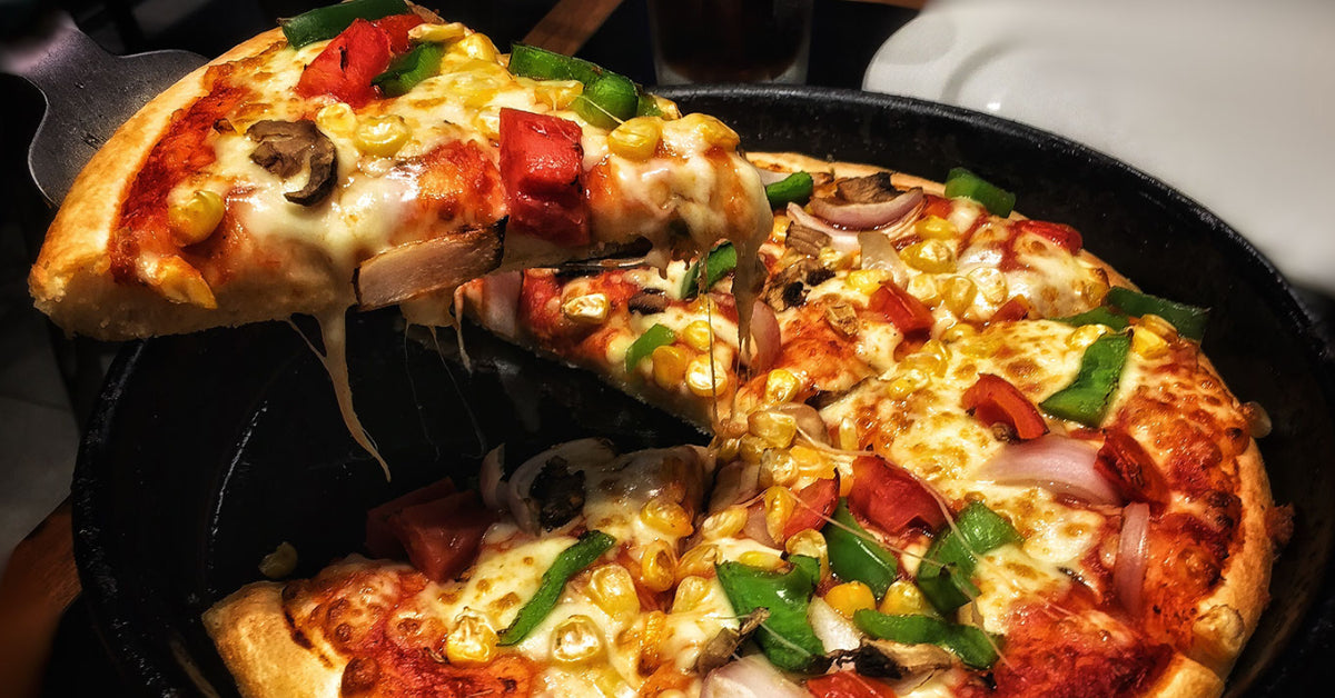 grilled pizza around the campfire