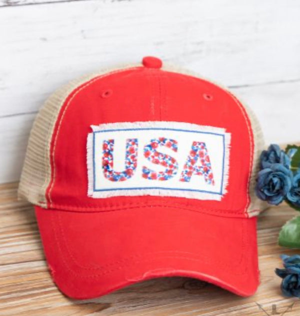 Floral USA patch on distressed messy bun ponytail hat
