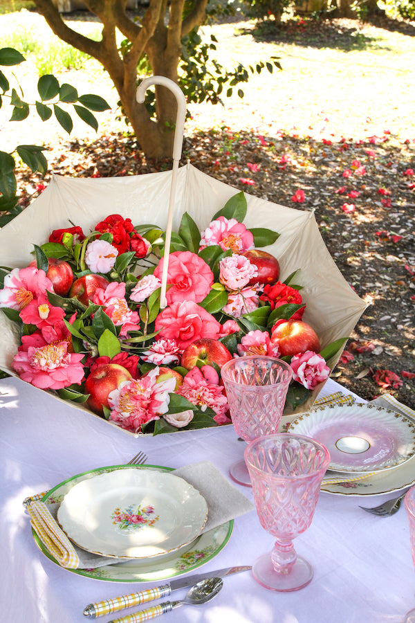 A floral filled umbrella centerpiece from Libbie Summers