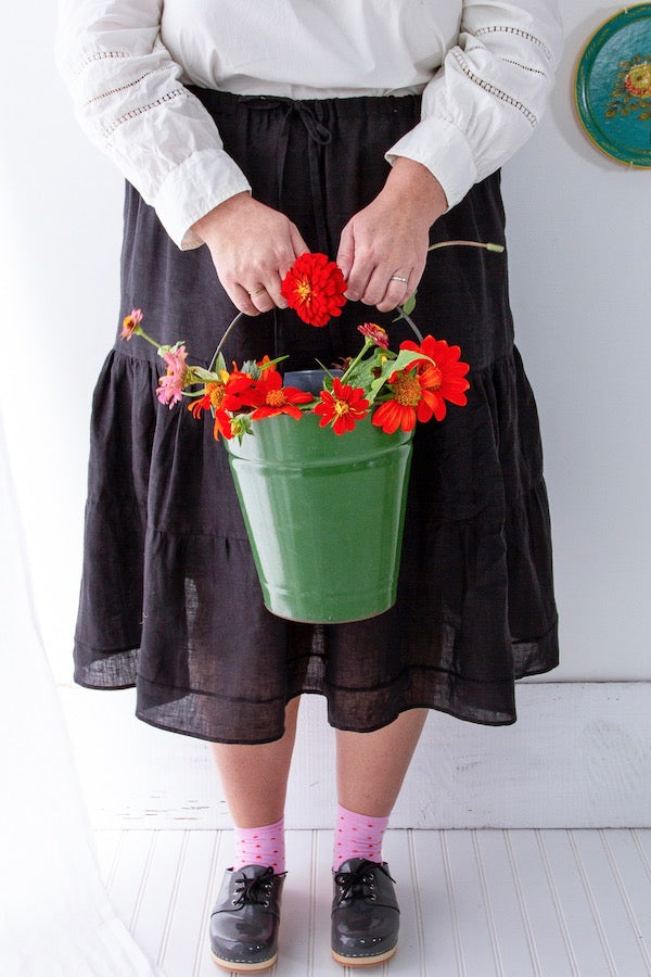Tiered A-line Midi Skirt from Libbie Summers with bucket of zinnias