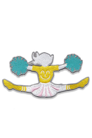 Team Yum Yum Smile Shop varsity cheerleading cheerleader sew on embroidery patch accessory with smile face shirt, pink pleated cheerleading skirt and blue pom poms.