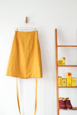 EVERYDAY BEAUTIFUL A-LINE APRON WRAP SKIRT IN MUSTARD LINEN