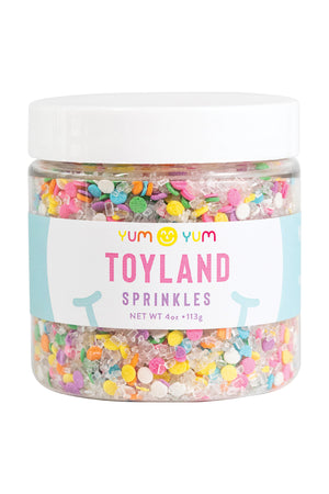 Toyland Sprinkles. Pastel sugar sequin sprinkles in a snow bank of white crystal prism sugar. Yum Yum Smile Shop Sprinkles. Holiday Sprinkles