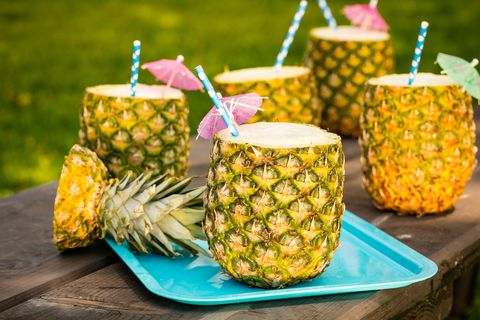 pineapple colada cocktail mixed drink in a pineapple